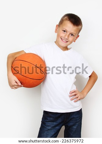 boy in a white shirt with a basketball  - stock photo