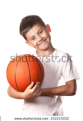 boy in a white vest holds a ball for game in basketball - stock photo