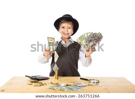 boy in black hat counting money on the table, isolated on white - stock photo