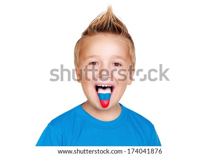 boy in blue shirt with russian flag on his  tongue - stock photo