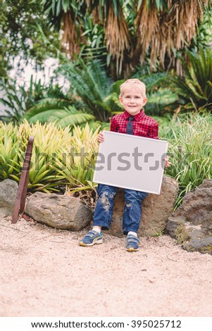 boy in business suit with white board - stock photo