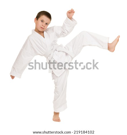 boy in clothing for martial arts posing