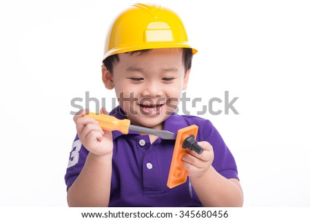 boy in construction helmet isolated on white background. Adorable future engineer over a white background - stock photo