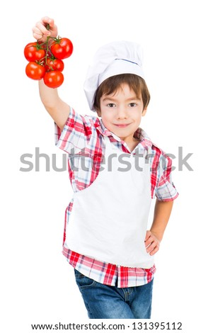 boy in dress Food Boy with tomatoes on white background - stock photo