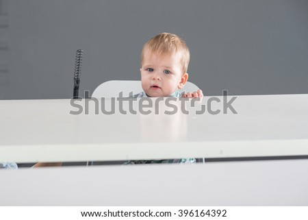 Boy in front of the mirror