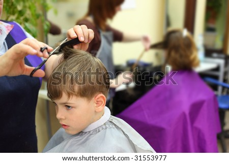Boy in hairdressing salon - stock photo
