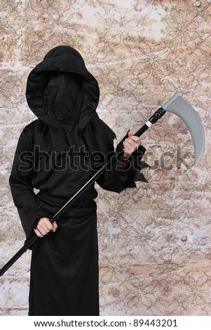 Boy in Halloween Suit with weapon in hand - stock photo