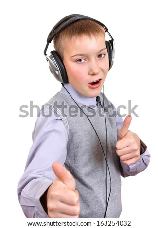 Boy in Headphones shows OK Gesture Isolated on the White Background - stock photo
