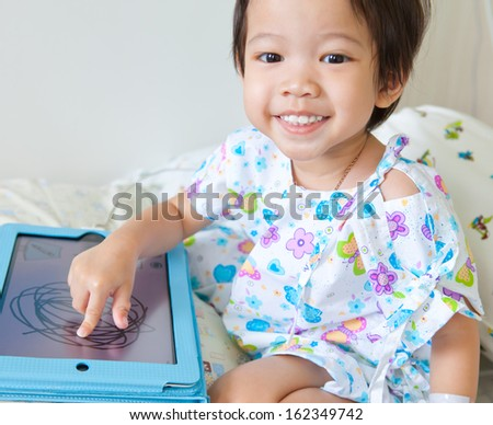 Boy In Hospital With Tablet - stock photo