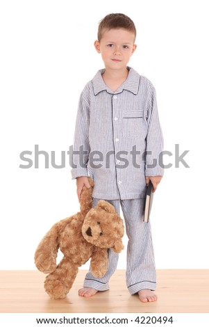 boy in pijama with his teddy bear and book isolated on white - stock photo