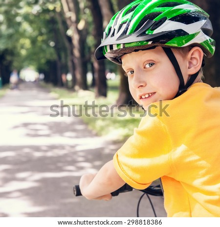Boy in safe bicycle helmet close up portrait - stock photo