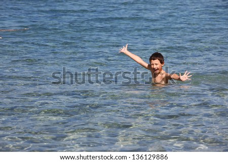 boy in sea - stock photo