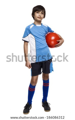 Boy in sport wear with football isolated on white background - stock photo