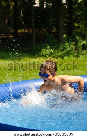 Boy in swimming pool - stock photo