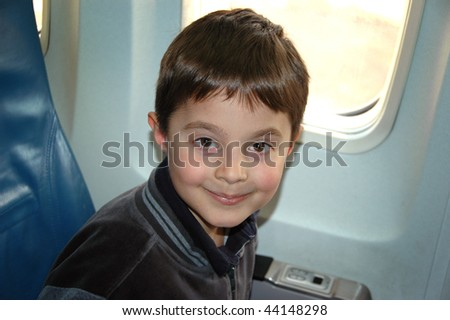 Boy in the airplane - stock photo