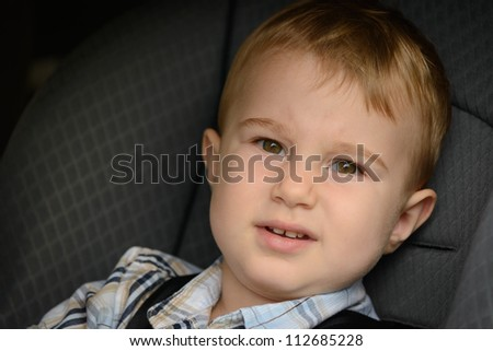 Boy in the car seat