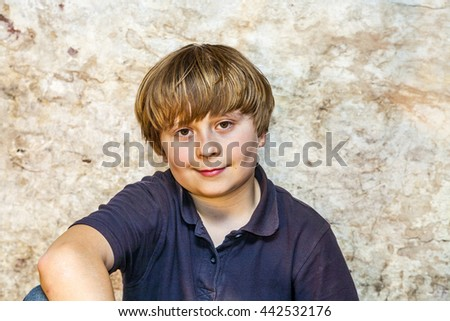 boy in the  cellar with a spotlight and an old brick wall