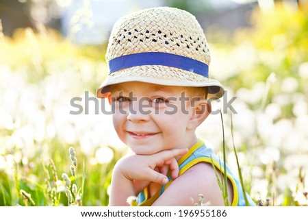 boy in the dandelions - stock photo