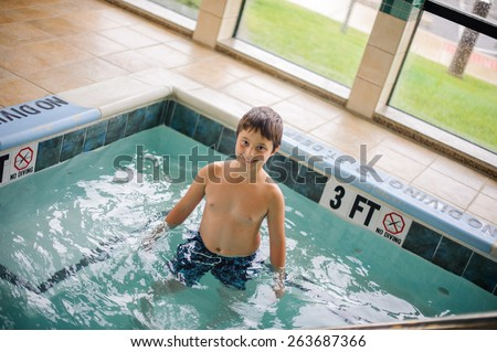 Boy in the hot tub - stock photo