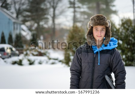 Boy in the snow - stock photo