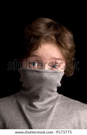 Boy in Turtleneck over a black background - stock photo