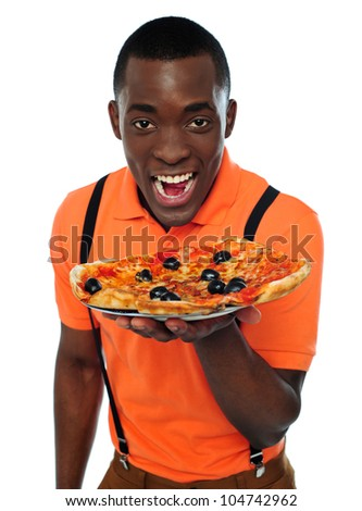 Boy in uniform offering pizza isolated on white background