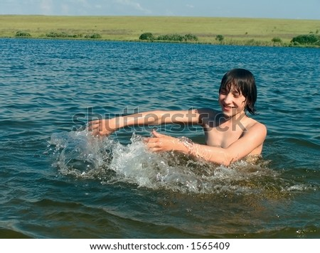 boy in water - stock photo