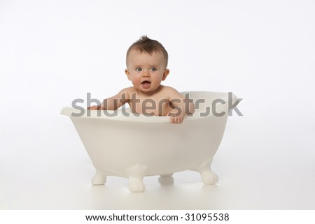 Boy in white bath tub