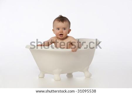 Boy in white bath tub - stock photo