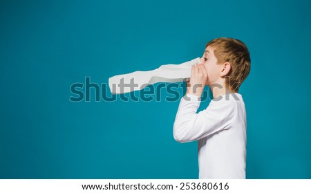 Boy in white clothes blowing his nose - stock photo