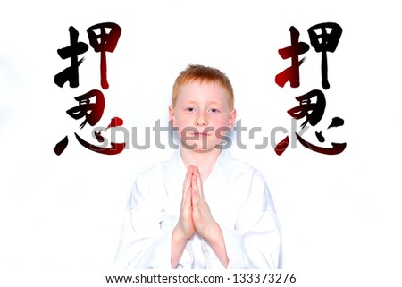 Boy in white kimono folds his hands in a greeting - stock photo