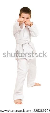 boy in white kimono for martial arts posing - stock photo