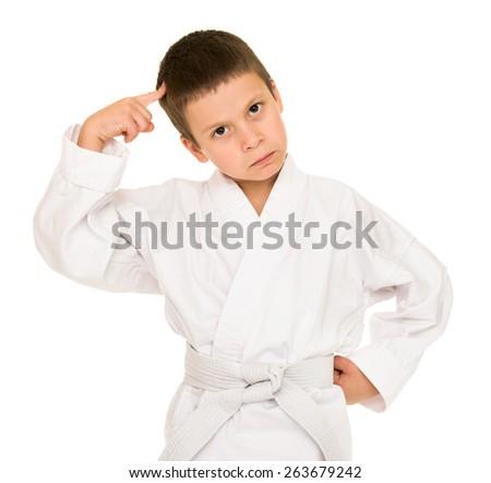 boy in white kimono posing - stock photo