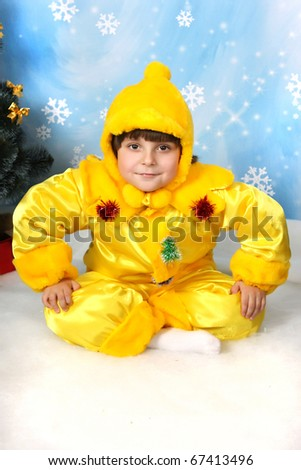 boy in yellow costumes and hat