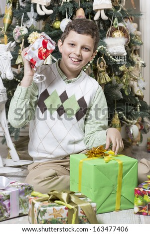 Boy intrigued with Christmas gift