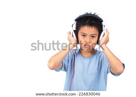 boy is listening to music - stock photo