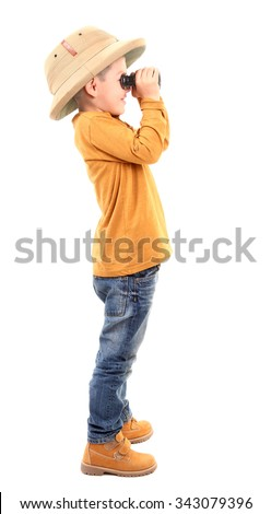 Boy is looking through binoculars - stock photo