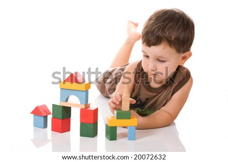 boy is playing blocks