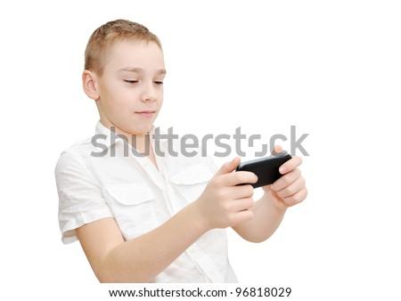 Boy is playing racing game on smartphone - stock photo