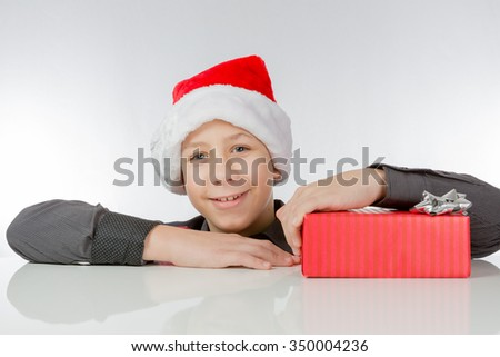 Boy is pleased about a present packed red