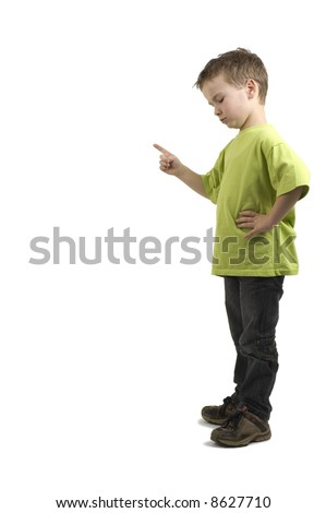 Boy is pointing his finger down to... use the copy space for that! - stock photo
