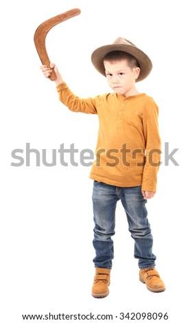 Boy is throwing boomerang - stock photo