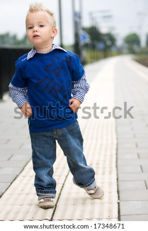 Boy is waiting for the train - stock photo