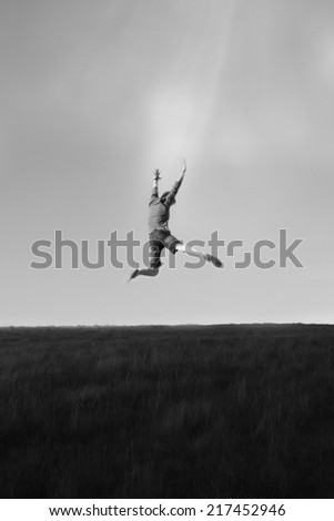 Boy Jumping In Air - stock photo