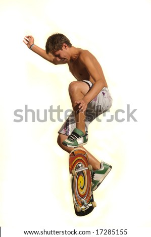 Boy jumping with a skateboard isolated against a white background