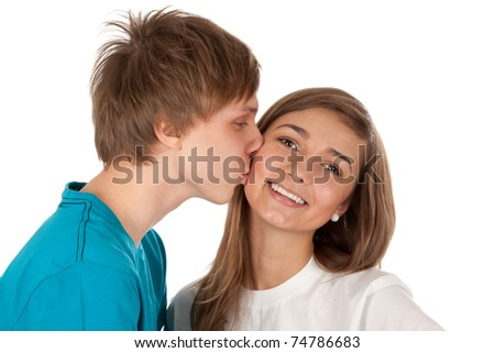 Boy kisses girl isolated on white background