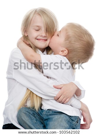 boy kissing a girl. isolated on white background - stock photo