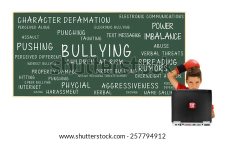 Boy Laptop Stop Cyber Bullying and Blackboard Bullying Children At Risk: Power Imbalance, Pushing, Cyber Bullying, Assault, Harassment, Hitting, Verbal Abuse, Property Damage, Spreading Rumors - stock photo