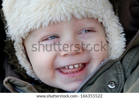 boy laughing in winter - stock photo