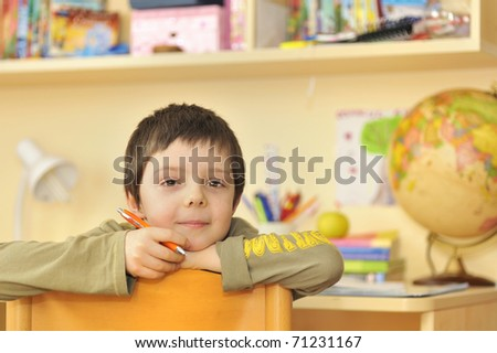 boy learning at home - stock photo